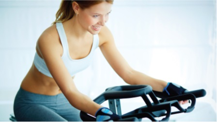 Lady on an exercise bike